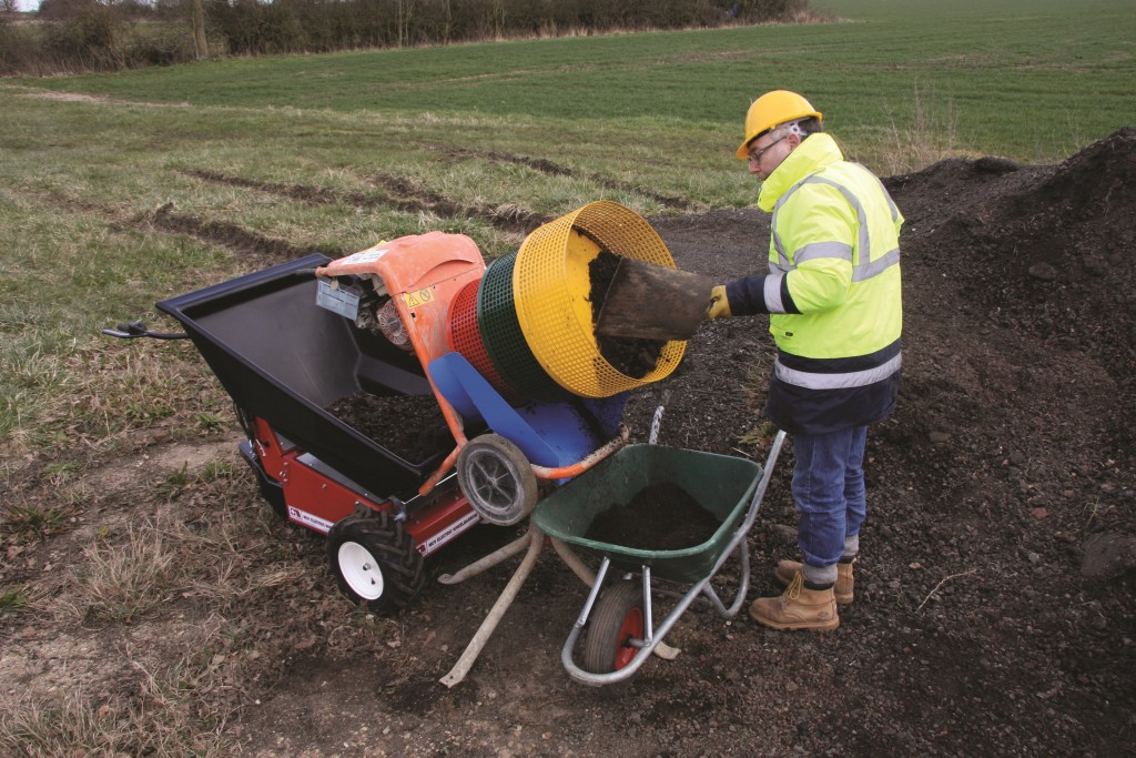 Material has to be carefully fed into the outer yellow drum to prevent any falling straight down into the front barrow.