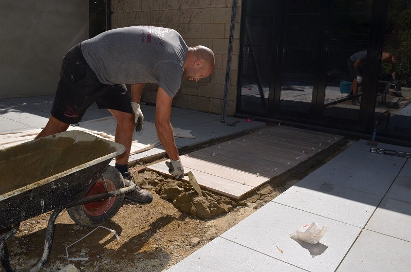 Professional Builder Visits Bradstone's Madera Porcelain Paving Being Laid