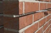 What can be done about cracking in masonry walls?